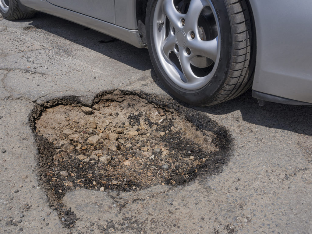 What Pothole Damage Can Do to Your Car | Virginia Tire & Auto